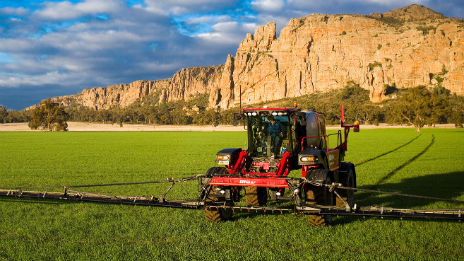 Tractor working a paddock in front of Mt Arapiles.